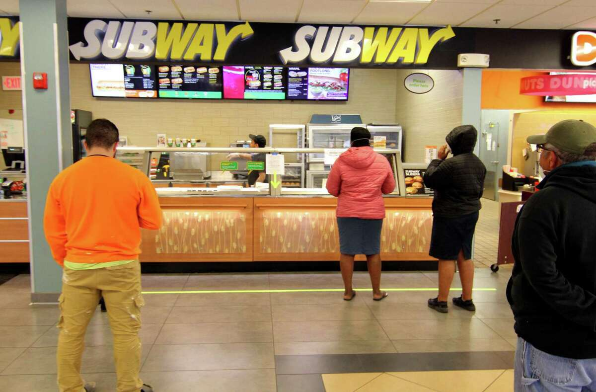 Customers wait for food at Subway at the 1-95 northbound rest plaza in Milford, Conn., on Thursday Mar. 2, 2020.