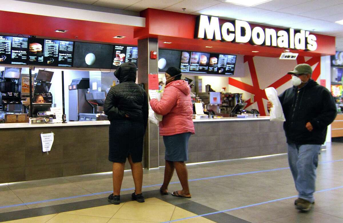Customers wait for food at McDonald's at the 1-95 northbound rest plaza in Milford, Conn., on Thursday Mar. 2, 2020.