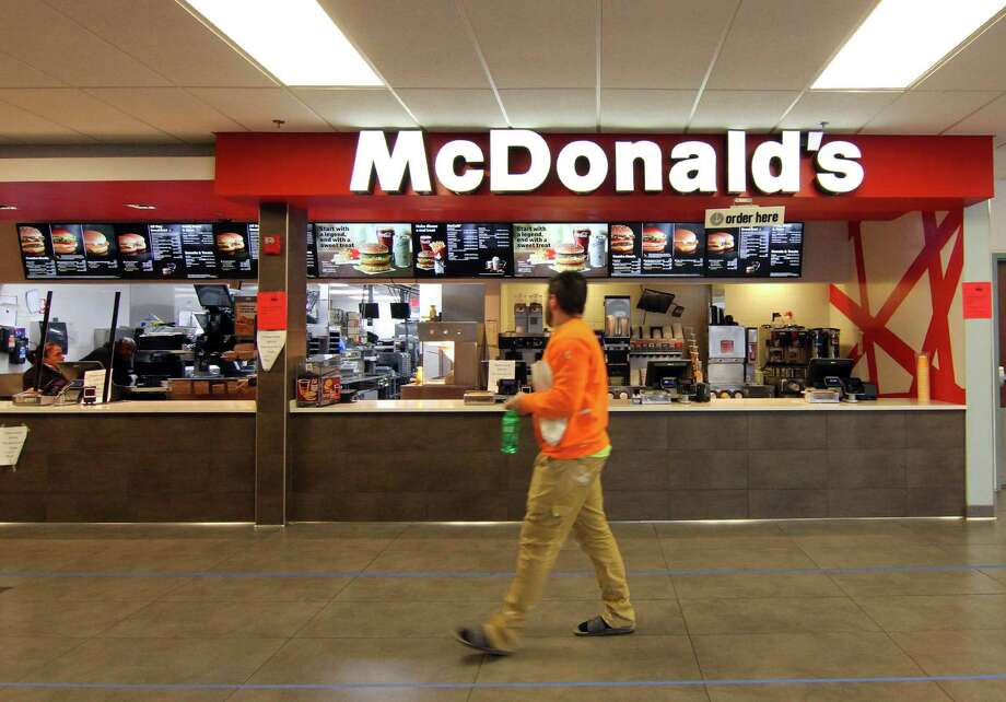A customer walks past McDonald's at the 1-95 northbound rest plaza in Milford, Conn., on Thursday Mar. 2, 2020. Photo: Christian Abraham / Hearst Connecticut Media / Connecticut Post