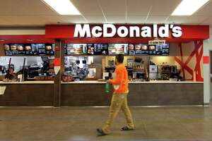 A customer walks past McDonald's at the 1-95 northbound rest plaza in Milford, Conn., on Thursday Mar. 2, 2020.