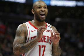 Houston Rockets forward P.J. Tucker (17) speaks with his bench in the second half during an NBA basketball game against the Utah Jazz Monday, Jan. 27, 2020, in Salt Lake City. (AP Photo/Rick Bowmer)