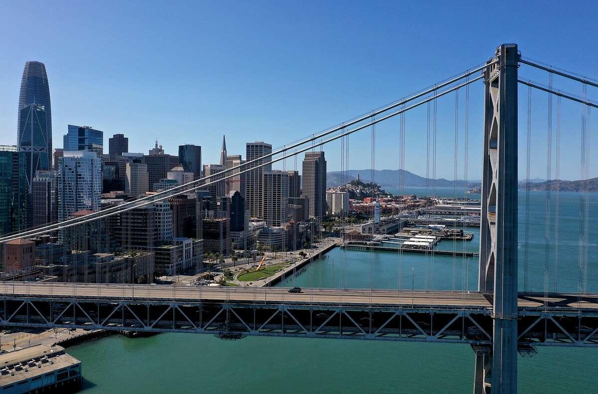 FILE: A single car drives west on the Bay Bridge on April 1, 2020.