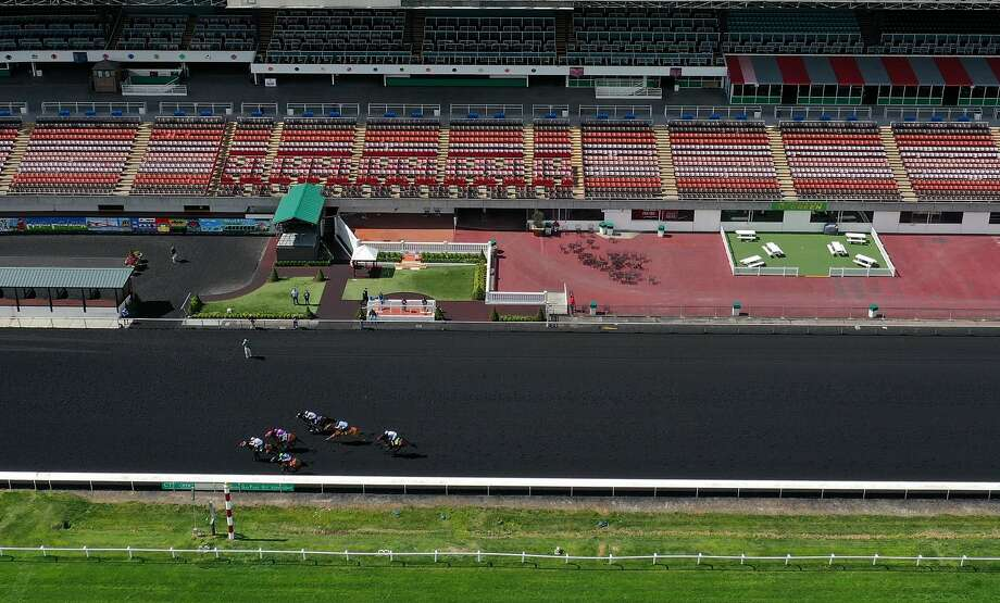 BERKELEY, CALIFORNIA - MARCH 19: Horse racing continues at Golden Gate Fields with no fans in attendance due to coronavirus concerns on March 19, 2020 in Berkeley, California. As millions of people in the San Francisco Bay Area are under a shelter in place order due to COVID-19, horse racing at Golden Gate Fields continues but the events are not open to the public. (Photo by Justin Sullivan/Getty Images) Photo: Justin Sullivan / Getty Images