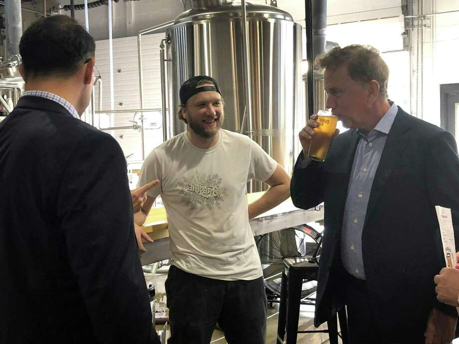 Gov. Ned Lamont samples a beer at Tribus Beer Co. in Milford Thursday Oct. 4, 2018. Photo: Kaitlyn Krasselt / Hearst Connecticut Media / Connecticut Post