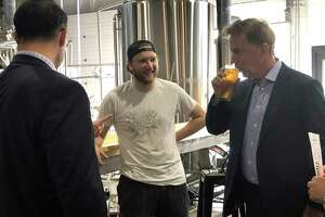 Gov. Ned Lamont samples a beer at Tribus Beer Co. in Milford Thursday Oct. 4, 2018.