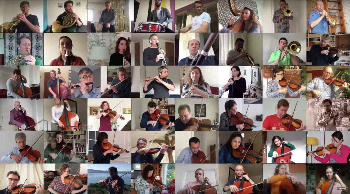 """In this handout photo provided by the National Orchestra of France on Wednesday April 1, 2020, musicians from the National Orchestra of France are shown in the screenshot as a patchwork, each performing parts of """"Bolero"""" alone in lockdown. The musicians recorded themselves over several days in March for this video posted by the orchestra on March 29. With the magic of technology, their individual videos were woven together to create a rousing orchestra-like sound for the famous piece of music by French composer Maurice Ravel. (National Orchestra of France via AP)"""