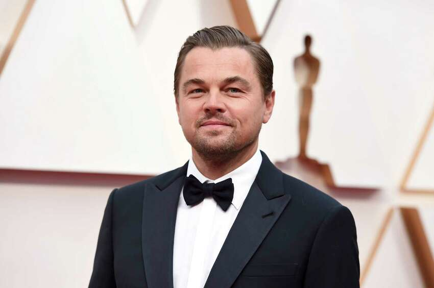FILE - In this Feb. 9, 2020, file photo, Leonardo DiCaprio arrives at the Oscars in Los Angeles. DiCaprio is helping to launch the $12 million Americaa€™s Food Fund aimed at helping low-income families, the elderly and those whose jobs have been disrupted by the coronavirus pandemic. Among those teaming up for the launch are philanthropist Laurene Powell Jobs, Apple and the Ford Foundation. (Photo by Jordan Strauss/Invision/AP, File)