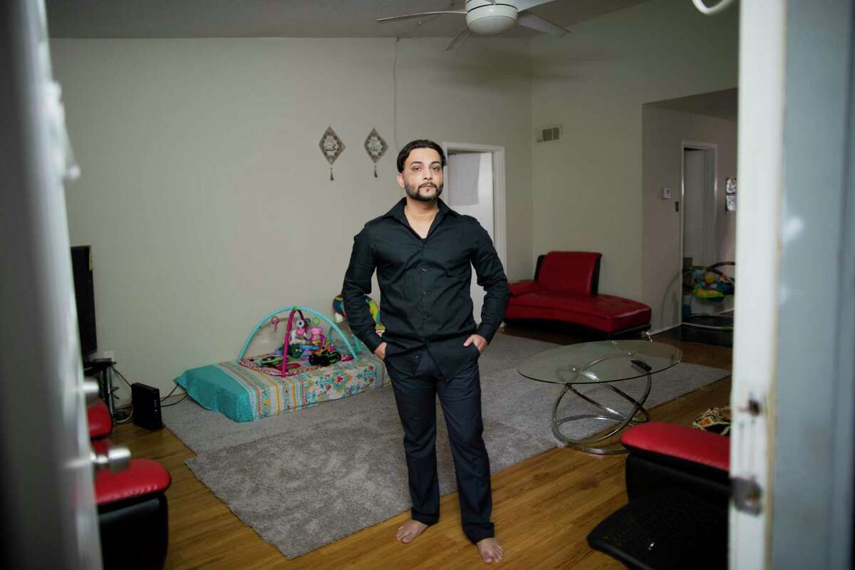 After tracking the trajectory of the Covid-19 from China to western countries Muhammad Ali, a car sharing driver stop providing ride services in early March to protect his family from the virus. Ali stands on the living room of his room in Houston on Thursday, April 2, 2020.