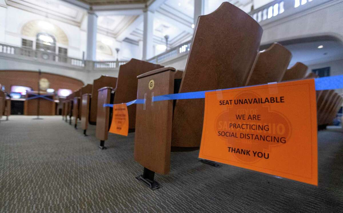 Signs indicate which seats are unavailable in the City Council chambers due to coronavirus social distancing requirements. The council heard sobering news Thursday about a projected $100 million shortfall in the city budget due to the economic fallout caused by the pandemic.