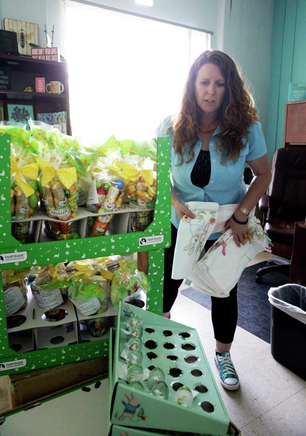 CEO Merideth Erickson sorts Easter merchandise donated by Cost Plus World Market as Alpha Home staff have some fun stuffing Easter baskets.