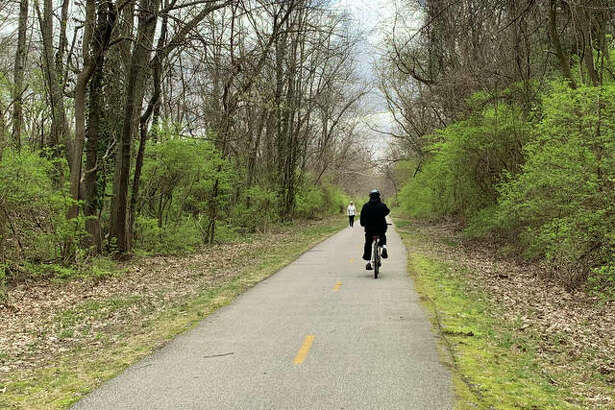 The MCT Trails in Edwardsville remain busy as residents escape their homes to enjoy the sunny weather during the stay-at-home order for the coronavirus outbreak.