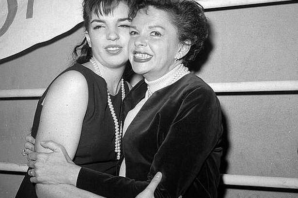 """Singer-actress Judy Garland hugs her 17-year-old daughter Liza Minnelli after watching Liza star in the Off-Broadway revival of the 1941 musical """"Best Foot Forward"""" in New York City, April 3, 1963. (AP Photo/Marty Lederhandler)"""