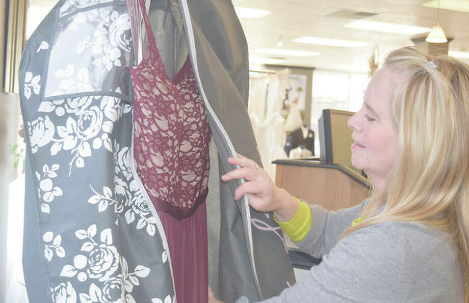 Terryl Boulanger prepares a prom dress for pick-up at Girls in White Satin. Photo: Samantha McDaniel-Ogletree | Journal-Courier
