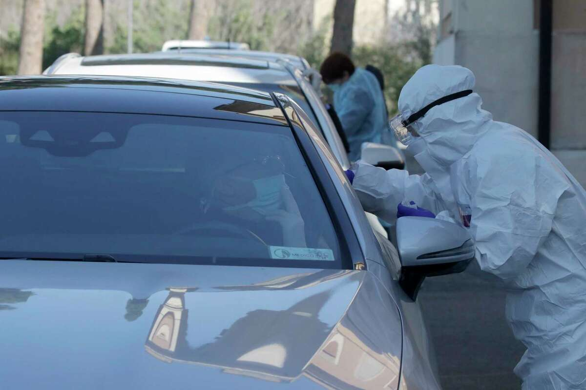Medical staff of a mobile unit take samples from people in cars to test for Covid-19 at a drive-through position at the Santa Maria della Pieta' hospital complex, in Rome, Friday, April 3, 2020. The new coronavirus causes mild or moderate symptoms for most people, but for some, especially older adults and people with existing health problems, it can cause more severe illness or death. .