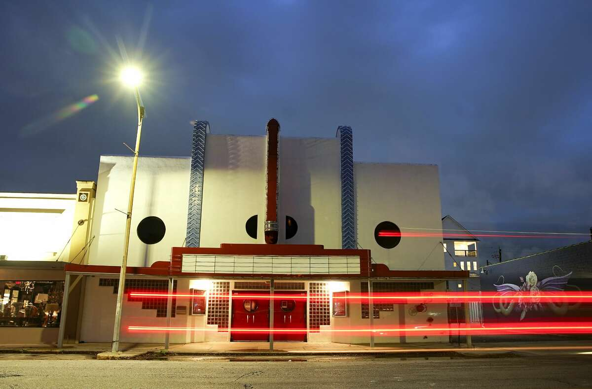 The Heights Theater had its lights off and marquee blank in Houston on Friday, March 20, 2020.Analysts expect films to spend less time in theaters before they become available in living rooms after the pandemic subsides.