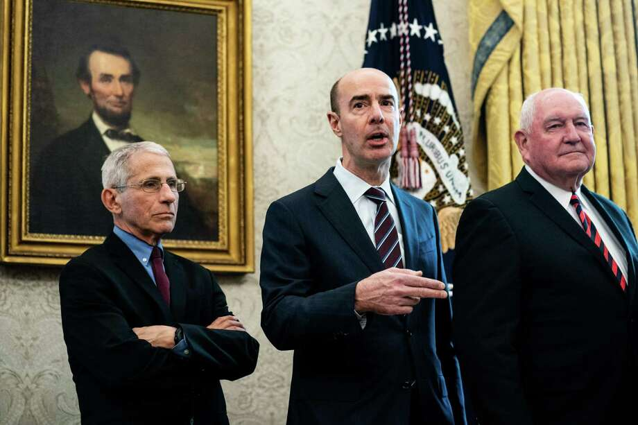 U.S. Labor Secretary Eugene Scalia, center, alongside (L-R) Tony Fauci, director of the National Institute of Allergy and Infectious Diseases, and Agriculture Secretary Sonny Perdue, on March 27, 2020 at the White House. (Photo by Erin Schaff-Pool/Getty Images) Photo: Pool / Getty Images / 2020 Pool