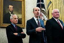 U.S. Labor Secretary Eugene Scalia, center, alongside (L-R) Tony Fauci, director of the National Institute of Allergy and Infectious Diseases, and Agriculture Secretary Sonny Perdue, on March 27, 2020 at the White House. (Photo by Erin Schaff-Pool/Getty Images)