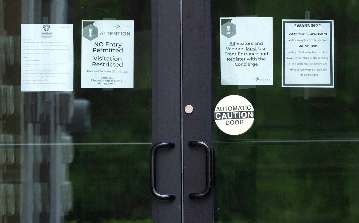 Safety notices are posted on doors to The Conservatory at Alden Bridge after several residents tested positive for coronavirus, Friday, April 3, 2020, in The Woodlands. On Monday, Montgomery County Judge Mark Keough issued a shelter-in-place order for residents of the senior living community that offers apartment homes for up to 237 residents.