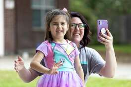 Mikayla Bullock ,5, and her mother, Heather Bullock, react as the Atascocita Fire Department and residents of Eagle Springs wish Mikayla a happy birthday, Thursday, April 2, 2020.