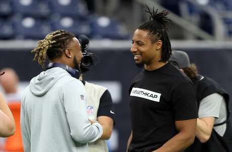 HOUSTON, TEXAS - SEPTEMBER 29: Eric Reid #25 of the Carolina Panthers, right, and Justin Reid #20 of the Houston Texans talk during warm ups before playing at NRG Stadium on September 29, 2019 in Houston, Texas. (Photo by Bob Levey/Getty Images)