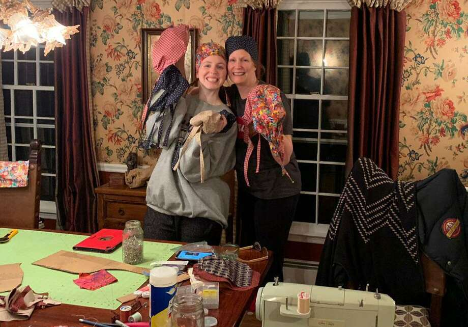 Answering a call by nurses for scrub caps, Nancy Pantoliano, right, and her daughter Dani are making caps at their home in Wilton. Photo: Contributed Photo