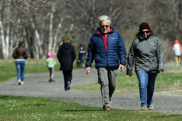 Visitors take adavantage of the nice weather Wednesday, April 1, 2020, at Sherwood Island State Park in Westport, Conn.