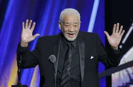 """FILE - This April 18, 2015 file photo shows singer-songwriter Bill Withers speaking at the Rock and Roll Hall of Fame Induction Ceremony in Cleveland. Withers, who wrote and sang a string of soulful songs in the 1970s that have stood the test of time, including """"Lean On Me,"""" """"Lovely Day"""" and """"Ain't No Sunshine,"""" died in Los Angeles from heart complications on Monday, March 30, 2020. He was 81. (AP Photo/Mark Duncan, File)"""