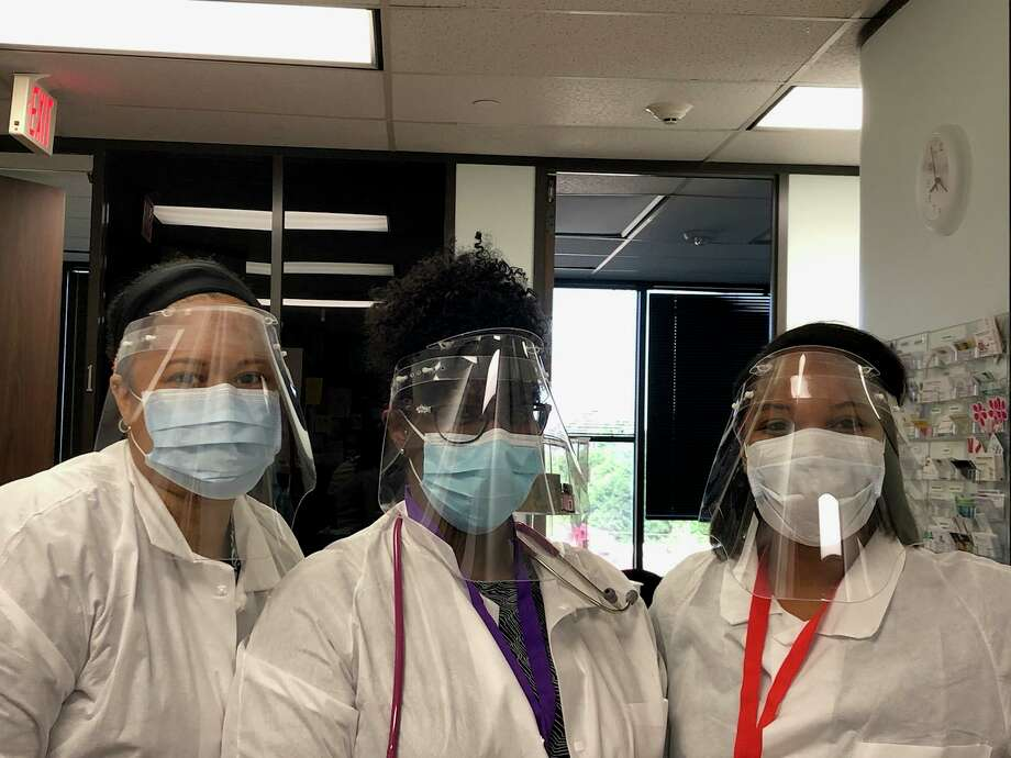 Texas Torque, CISD's FIRST robotics team, is working with two other robotics teams in the state to make protective face shields for medical personnel as the demand for the equipment is high all across the country. Staff at a clinic in Shenandoah with their Texas Torque provided masks. Photo: Provided