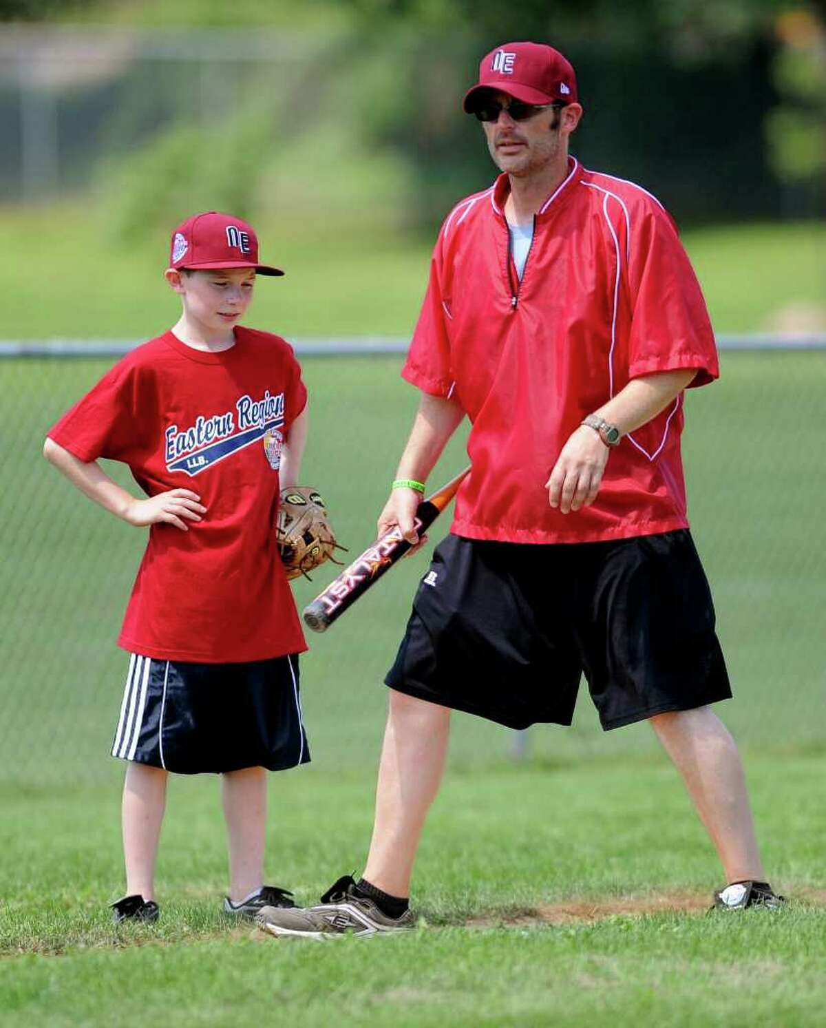 Fairfield American coach Larry Klein gives his son, Nate, some pointers during practice on Thursday, August 19, 2010.