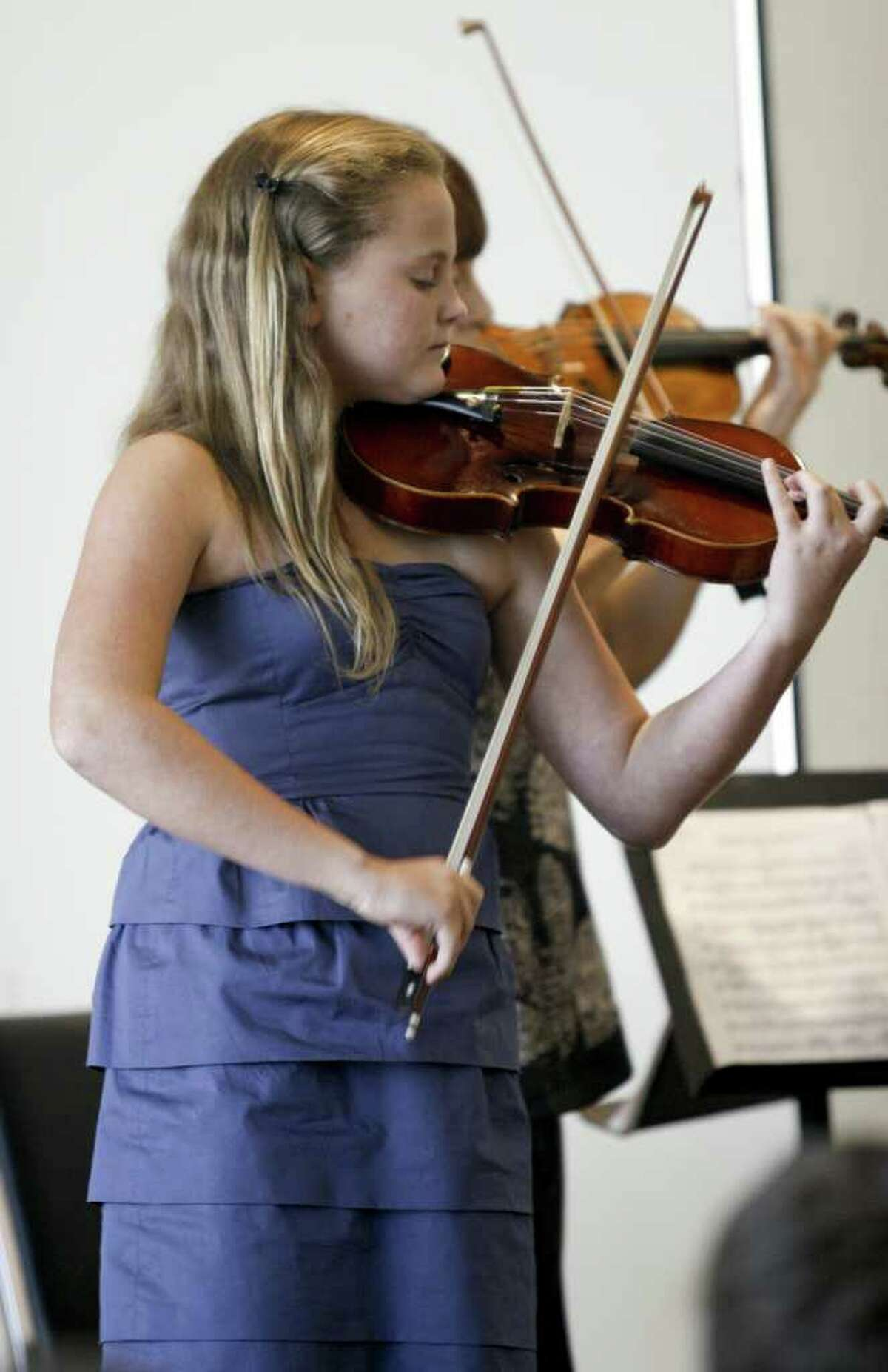 Anna Leunis of Darien, age 14, performs a duet with Asya Meshberg, Artistic Director of the Chamber Music Institute for Young Musicians, after receiving an award and scholarship from the Stamford Center for the Arts on Sunday, August 8, 2010.