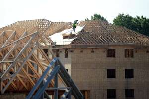 Construction continues in 2015 at a 262-unit apartment complex in Shelton.