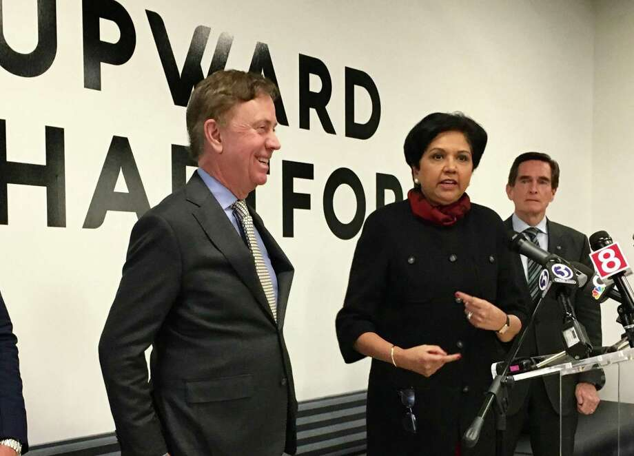 Gov. Ned Lamont and former PepsiCo CEO Indra Nooyi in February 2019 in Hartford, Conn. Photo: Dan Haar /Hearst Connecticut Media