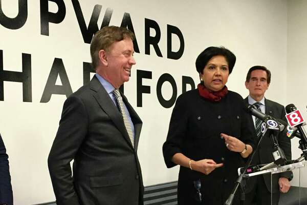 Gov. Ned Lamont and former PepsiCo CEO Indra Nooyi in February 2019 in Hartford, Conn.