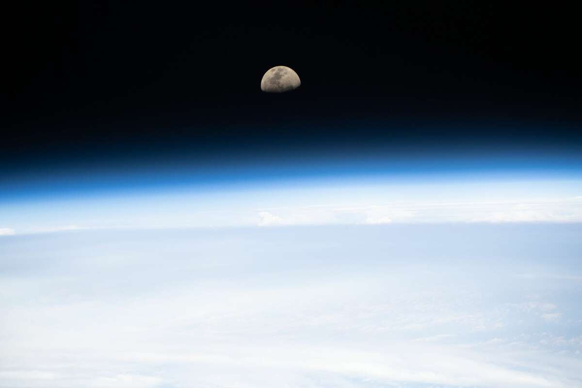 A first quarter moon is pictured as the International Space Station orbited 265 miles above the South Pacific on Jan. 4, 2020.