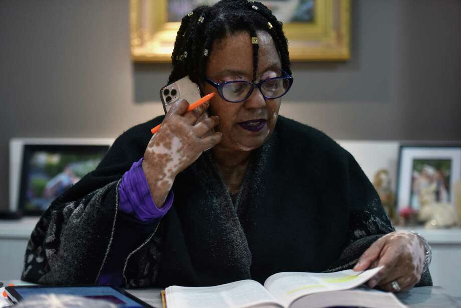 Darlene Curry and her husband run a home church where they believe they have regularly healed people through their hands-on prayer. Now, because of the coronavirus, they are praying with people via phone. Curry is shown here at home in Severn, Md., on March 28. Photo: Washington Post Photo By Marvin Joseph. / The Washington Post