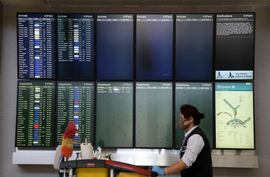 More than half of the arrivals and departures boards are blank at San Francisco International Airport on April 02, 2020 in San Francisco, California. Due to a reduction of flights and people traveling, San Francisco International Airport has consolidated all of its terminals into one concourse in the international terminal. Photo: Justin Sullivan/Getty Images / 2020 Getty Images