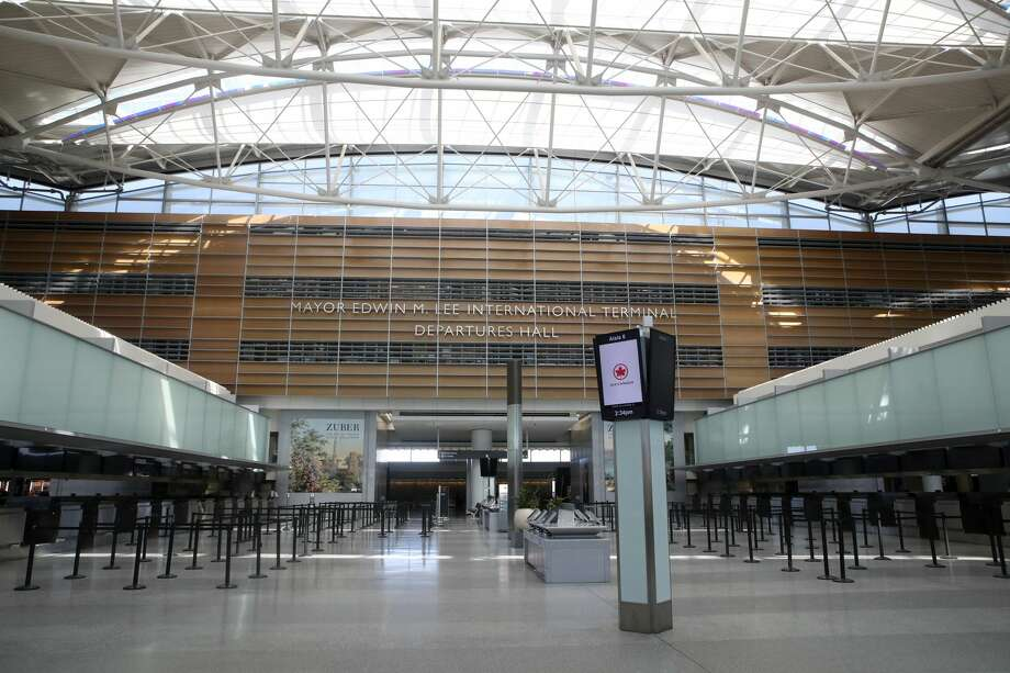 The Mayor Edwin M. Lee International Terminal departures hall sits empty at San Francisco International Airport on April 02, 2020 in San Francisco, California. Due to a reduction of flights and people traveling, San Francisco International Airport has consolidated all of its terminals into one concourse in the international terminal. Photo: Justin Sullivan/Getty Images / 2020 Getty Images