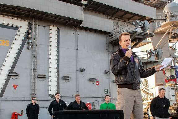 (Dec. 19, 2019) Capt. Brett Crozier, commanding officer of the aircraft carrier USS Theodore Roosevelt (CVN 71), gives remarks during an all-hands call on the ship's flight deck Dec. 15, 2019. Theodore Roosevelt is underway conducting routine training in the Eastern Pacific Ocean. (U.S. Navy photo by Mass Communication Specialist Seaman Alexander Williams)