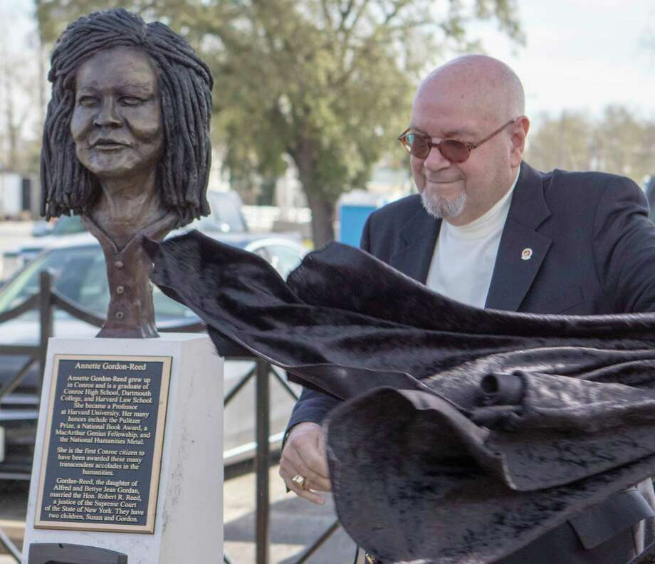 Dave Parsons unveils the bust of professor Annette Gordon-Reed during an unveiling ceremony Friday, Feb. 15, 2019 at Founder's Plaza park in Conroe. Gordon-Reed has won several accolades including a Pulitzer Prize in History. Photo: Cody Bahn, Houston Chronicle / Staff Photographer / © 2018 Houston Chronicle