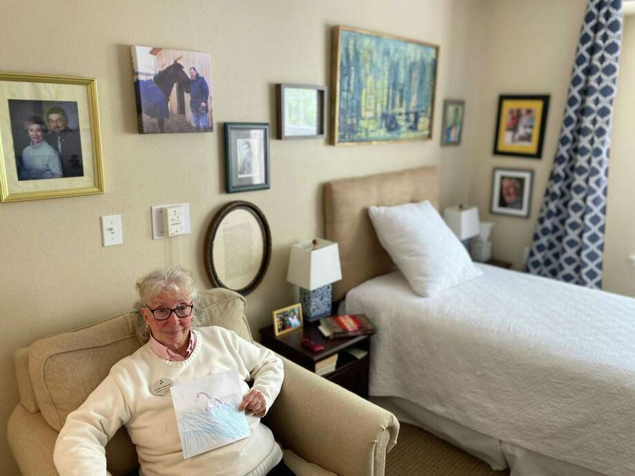 Judith Schroeder, a resident of Brookdale Senior Living in the Heights, received a letter and a drawing of a horse, her favorite animal. Photo: Betsy Wilkins