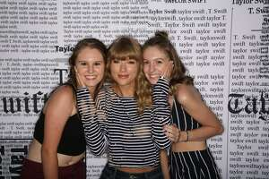 Jess Buslewicz (right) pictured with her sister, Jordan, and pop star Taylor Swift in 2018.
