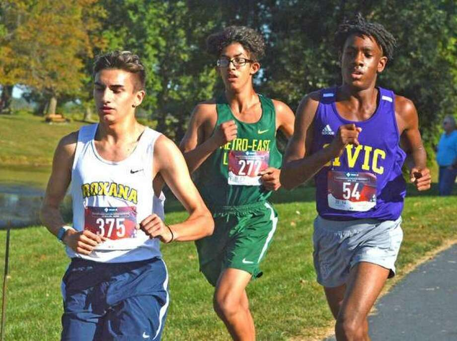 In this file photo, Metro-East Lutheran freshman Elijah Schlessinger, middle, runs on Oct. 8 in the small-school boys race in the Madison County Meet at Belk Park in Wood River. Photo: Scott Marion/The Intelligencer