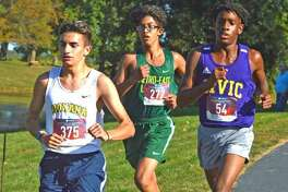 In this file photo, Metro-East Lutheran freshman Elijah Schlessinger, middle, runs on Oct. 8 in the small-school boys race in the Madison County Meet at Belk Park in Wood River.