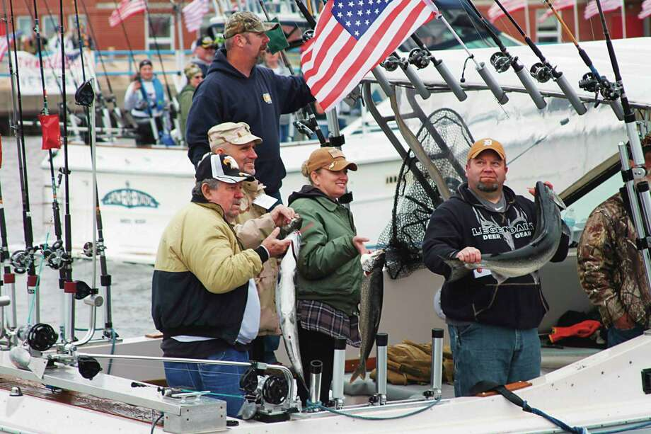 Veterans and their family members show off their morning catch during Tight Lines for Troops in 2019. The board of directors made the decision to cancel this year's event due to concerns over the coronavirus. (File photo)