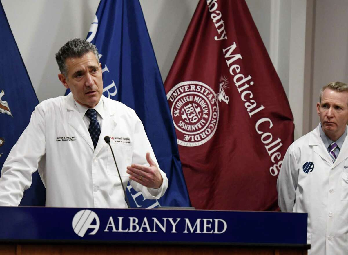Dr. Steven D. Hanks, chief clinical officer for St. Peter's Health Partners, left, and Dr. Dennis P. McKenna, president and CEO of Albany Medical Center, right, speak to reporters during a joint press conference where leaders from Capital Region hospitals gave updates on their ongoing coronavirus preparations on Friday, April 3, 2020, at Albany Med in Albany, N.Y. (Will Waldron/Times Union)