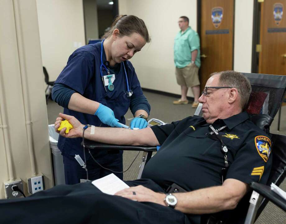 A donor gives blook at the Gulf Coast Regional Blood Bank on Tuesday. Blood and plasma donations are needed now more than ever as a number of blood drives have been canceled due to the COVID-19 pandemic. Do your part and make an appointment. Photo: Gustavo Huerta /Staff Photographer / Houston Chronicle © 2020