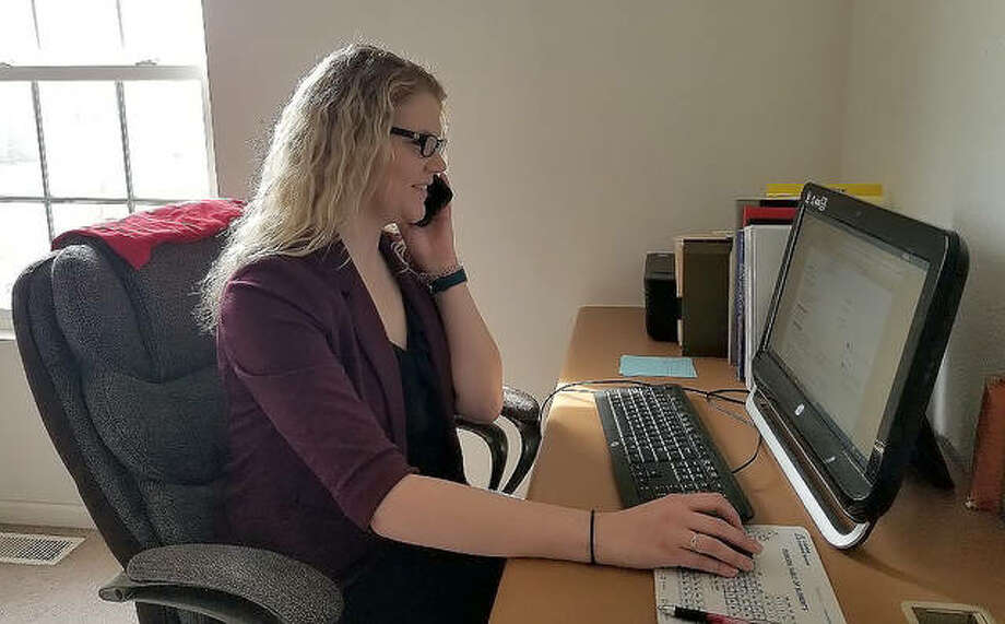 Megan Scribner, a counselor at the SIUE Career Development Center, conducts a virtual meeting with a student on Thursday. With the SIUE campus being shut down due to the coronavirus outbreak, the center has moved all of its appointments, meetings and presentations online. Photo: For The Intelligencer