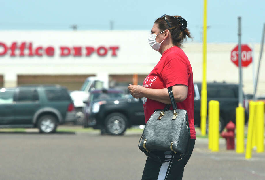 Shoppers cover their mouths with various types of face-masks, Wednesday, Apr. 1, 2020, outside the Wal-Mart San Bernardo Aveunue location. Photo: Danny Zaragoza/Laredo Morning Times