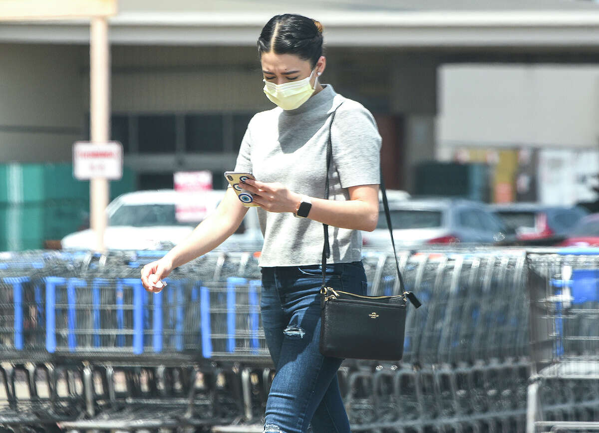 Shoppers cover their mouths with various types of face-masks, Wednesday, Apr. 1, 2020, outside the Wal-Mart San Bernardo Aveunue location.