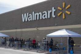 With companies limiting the number of customers able to come in the store, lines form outside like the north side Walmart 04/03/2020 for shoppers to enter. Tim Fischer/Reporter-Telegram